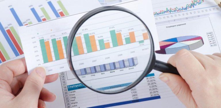 lupa e gráficos de pesquisas